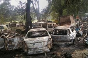 Charred vehicles which were set on fire by a mob in Bulandshahr over alleged cow slaughter.