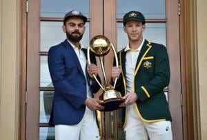 Australia cricket captain Tim Paine (R) and India cricket captain Virat Kohli (L) pose with the Border Gavaskar trophy.