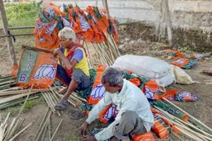 Workers ready BJP flags ahead of BJP National President Amit Shah