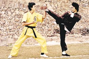 Bruce Lee (in black) in his breakout 1973 film, Enter The Dragon. By the time the film made him a global superstar, he was dead. He was just 32.