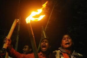 BJP supporters stage a torch rally against the attack on party's West Bengal unit chief Dilip Ghosh allegedly by Trinamool Congress goons ahead of Rath Yatra in Cooch Behar on Thursday.
