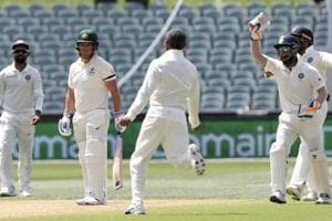 Indian players celebrate the dismissal of Australia