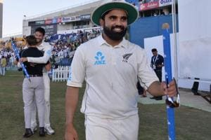 New Zealand cricketer Ajaz Patel (R) and Will Somerville (2nd L, background) celebrate as they return to the pavilion after their victory against Pakistan on the third and final Test cricket match between Pakistan and New Zealand