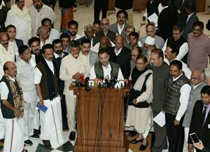 Congress president Rahul Gandhi with opposition parties leaders after meeting at Parliament Annexe in New Delhi on December 10.