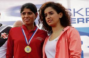 Swati Gadave (L) with Sanya Malhotra, actor and chief guest, at the Skechers Goa river half marathon in Goa on Sunday.