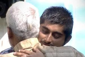 Deepak Thakur greets his father with a warm hug.