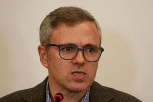 Former chief minister Jammu and Kashmir and vice president of National Conference (NC) Omar Abdullah (C) addresses a press conference in Srinagar on November 22.