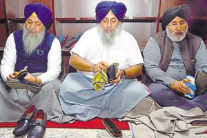 SAD chief Sukhbir Singh Badal (centre), SGPC president Gobind Singh Longowal (left ) and ex-minister Daljit Singh Cheema cleaning shoes at the Golden Temple on Sunday, December 9, 2018.