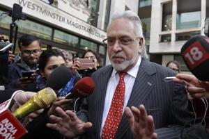 Businessman Vijay Mallya is surrounded by the media as he leaves Westminster Magistrates Court in London, Monday, Dec. 10, 2018. A British court has ordered that charismatic Indian tycoon Vijay Mallya should face extradition to India on financial fraud allegations.
