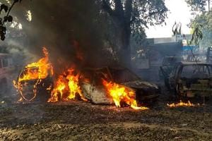Bulandshahr: Vehicles set on fire by a mob during a protest over the alleged illegal slaughter of cattle, in Bulandshahr, Monday, Dec. 03, 2018. According to Additional Director General of Meerut zone Prashant Kumar, protesters from Mahaw village and nearby areas pelted stones on the police and indulged in arson setting several vehicles and the Chingarwathi Police Chowki on fire. (PTI File Photo)