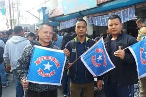 Mizo National Front supporters outside the party office in Aizawl as the party raced ahead in the Mizoram assembly elections (HT Photo)