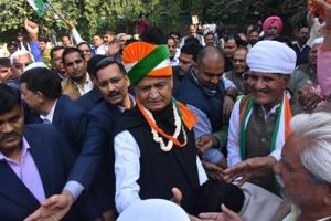 Congress leader and former chief minister Ashok Gehlot with supporters in Jaipur on Tuesday as trends showed the party leading in the assembly election results.
