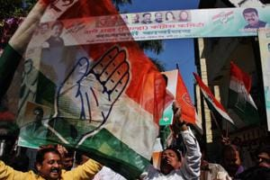 Congress workers celebrate in Thane on Tuesday.