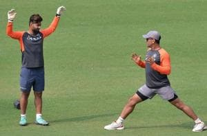 Rishabh Pant has credited MS Dhoni (right) for helping him evolve as a wicket-keeper and player.