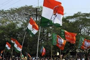Congress and BJP supporters wave flags.