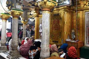 Women devotees offer prayers outside main dargah at Hazrat Nizamuddin Dargah in New Delhi