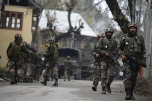 Indian army soldiers patrol during a cordon and search operation for suspected militants in Shuhama on the outskirts of Srinagar on November 5.