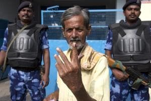 A man displays the indelible ink mark on his index fingers after casting his vote in Hyderabad, India, Friday, Dec. 7, 2018. This is the first state elections in Telangana after it was formed bifurcating Indian state of Andhra Pradesh.