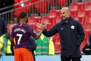 Manchester City manager Pep Guardiola celebrates with Raheem Sterling after the match