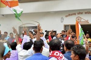 Congress workers celebrate the party