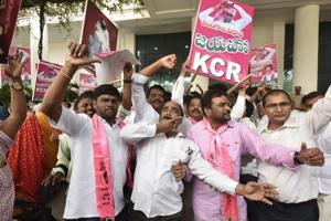 TRS supporters celebrate outside TRS Bhavan, Banjara Hills, Hyderabad, Telangana.