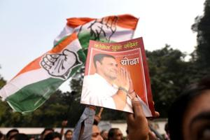 Congress supporters celebrate as the party gets lead in assembly elections at AICC in New Delhi on Tuesday.