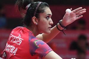Manika Batra serves in the table tennis mixed doubles semi-final.
