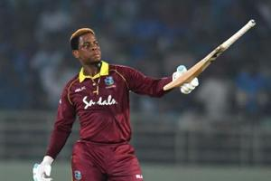 West Indies cricketer Shimron Hetmyer raises his bat after scoring a half century (50 runs) during the second one day international (ODI) cricket match between India and West Indies at the Dr. Y.S. Rajasekhara Reddy ACA-VDCA Cricket Stadium in Visakhapatnam
