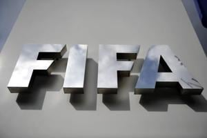 ZURICH, SWITZERLAND - OCTOBER 09: A FIFA logo next to the entrance at the FIFA headquarters on October 9, 2015 in Zurich, Switzerland. On Thursday, FIFA
