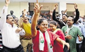 Congress party workers celebrate at Congress Bhavan, Shivajinagar, after the party clean sweeps the assembly polls in Chhattisgarh and Rajasthan states on Tuesday.