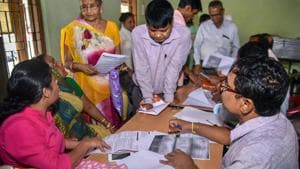 People verify the National Register of Citizens (NRC) forms to file claims and objections at an NRC centre, in Guwahati.