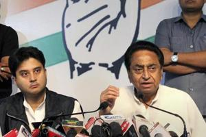Congress state president Kamal Nath (R), party leader and MP Jyotiraditya Scindia (L) during the release of Madhya Pradesh assembly election manifesto, at PCC headquarters in Bhopal on November 10.