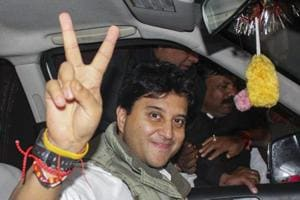 Congress party leader Jyotiraditya Scindia displays victory sign as he leaves after interacting with the media persons on the party