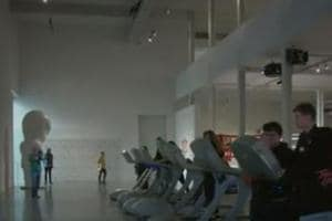 Visitors work out and at the same time witness art installations at  Hard Times gym exhibition in the Dox Gallery.