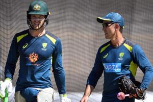 Australia cricket captain Tim Paine (L) talks with coach Justin Langer during a training session in Perth.