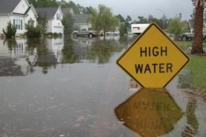 Sign warns of high water. Image for representation.