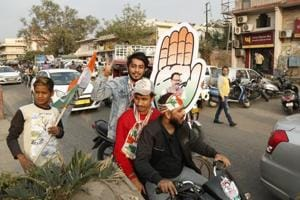 Congress party supporters celebrate the party