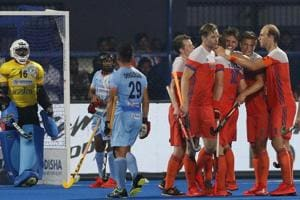 Netherlands players, in orange, celebrate after scoring a goal during the Men