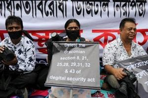 Journalists hold banners and placards as they protest against the newly passed Digital Security Act in front of the Press Club in Dhaka, Bangladesh, October 11, 2018.