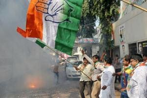 Congress party workers celebrate after the party leading in state assembly election of Rajasthan, MP, Chhattisgarh.