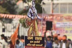 "Supporters of the Vishva Hindu Parishad (VHP) arrive to attend ""Dharma Sabha"" at Ramlila Ground in New Delhi on December 9."