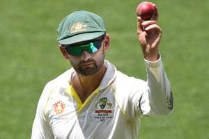 Nathan Lyon shows the ball as he leaves the field following his 6 wicket haul on day four of the first Test match.