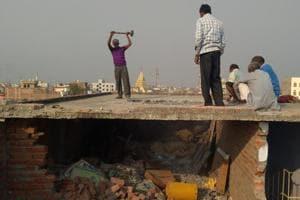 Muzaffarpur , India - Dec. 13, 2018: Laborers demolishing top floor of Muzaffarpur shelter home after sexual abuse case in Muzaffarpur District in Bihar , India, on Thursday, December 13, 2018. (Hindustan Times Photo)