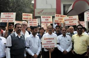 Members of TAAP protest outside the Air India office near Sangam bridge on Friday.