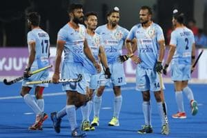 Indian players react after their loss against Netherlands in the Men