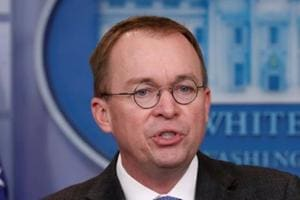 White House budget director Mick Mulvaney gestures as he holds a press briefing at the White House in Washington.