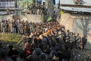 Villagers carry body of Zahoor Ahmed during his funeral procession, at Sirnoo village, Pulwama, south of Srinagar on December 15.