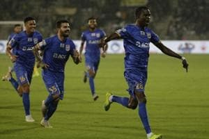 Modou Sougou, right, of Mumbai City FC celebrates with his team players after scoring a goal against Kerala Football FC.