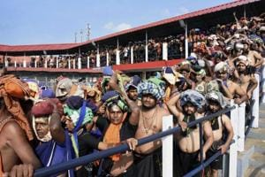Devotees queue up to offer prayers at Lord Ayyappa temple in Sabarimala.