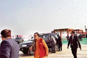 UP BJP chief Mahendra Nath Pandey and security personnel runfor cover as the Prime Minister Narendra Modi is made to sit in his vehicle behind them as bees hover in the area near Sangam on Sunday afternoon.